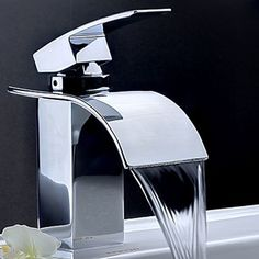 Contemporary Waterfall Bathroom Faucet -Chrome Finish.  Call Griggs Building and Design Group for your dream bathroom!!  989-835-8601 or visit us online at www.griggsbuilding.com