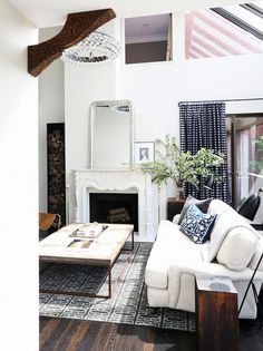 Living Room With White Couch And High Ceilings