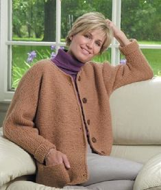 One-Stitch Adult Cardigan   An easy, flattering sweater that you'll want to live in! Features a jewel neckline and one-piece construction. Note: image is of the knitted version; the crochet version is similar but not identical. SKILL LEVEL:  Easy (Level 2)    SIZE: Small, Medium, Large, 1X, 2X, 3X