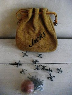 "Jacks - my mom played ""jacks"" and taught me how to play... in the Fifties.  That and Tiddly Winks."