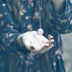 Crystal globe Luna pendant in rose quartz. Bohemian jewellery. Boho accessories.