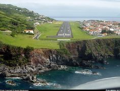 At Flores in the Azores: The airport at Santa Cruz, Flores. No airport existed prior to and the one here indicates that while tourism is the main business for the island, the tourist will enjoy relatively uncrowded stay. Have A Great Vacation, Great Vacations, Beautiful Islands, Beautiful Places, Peaceful Places, Aerial View, View Photos, Wonders Of The World, Places To See