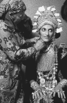 Yemen   Bride in wedding finery. Headdresses are part of the costume for special occasions in many cultures, such as this elaborately crafted bridal hood.   Photographer unknown