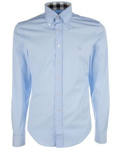 Long sleeve shirt from Burberry in pale blue with check pattern details on the cuffs and inside collar.