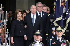 Former president Bush closed his eyes tightly as the family left the cathedral following the service on Thursday