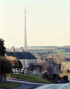 The tallest free-standing structure in Britain is the Emley Moor transmitter near Huddersfield, West Yorkshire. It stands 330.4 metres (1,084 feet) high