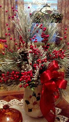 Evergreens And Red Berries.A Christmas Decoration That's Cheerful And Bright! Christmas Floral Arrangements, Christmas Centerpieces, Xmas Decorations, Vase Arrangements, Wedding Decorations, Country Christmas, Winter Christmas, Christmas Holidays, Merry Christmas