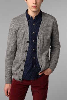 Grey cardigan, blue shirt, and deep red pants