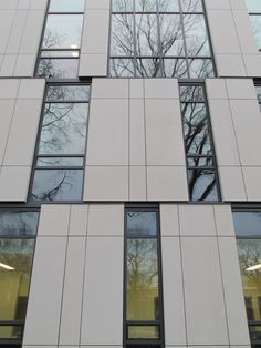 The primary facade features a checkerboard pattern of concrete panels and glazing. (Courtesy Urbahn Architects)
