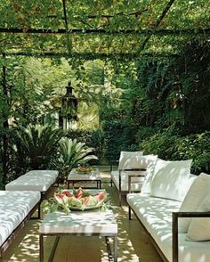 lovely cool patio under all that foilage, would be perfect with Crepe Myrtle vines above!!