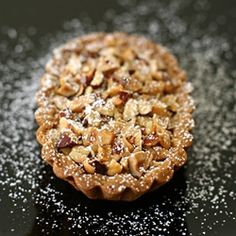 Tarte aux noisettes: pate sablee crust with almond and hazelnut cream, topped with chopped nuts