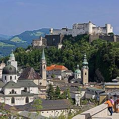 Salsburg, Austria.  Framed by mountains, crowned by the Hohensalzburg Fortress and divided by the turquoise Salzach River, the Salzburg landscape is pure drama