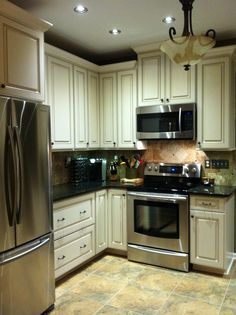 """We tore out the two 12"""" soffits and put in new cabinets that are taller than our old ones.  Now I literally have to get a ladder to reach the highest shelves (I keep Christmas dishes, etc. up there.), but I don't mind!!"""