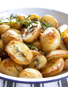 Roasted potatoes with rosemary, in old enamel bowl.
