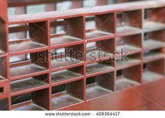 Red metallic grate wall