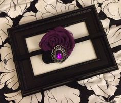 Baltimore Ravens themed headband.  Hand crafted flower blossoms accented with a gorgeous purple gem.  Via ILiveToLoveYou on etsy.    Www.etsy.com/shop/ILiveToLoveYou