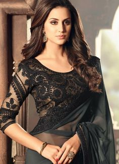25 Latest Black Saree Blouse Designs Black is a color that looks very interesting, classy and one can never go wrong in a black outfit. In fact, black also makes you look slim and hide the flabs. We've compiled the list of the beautif… Black Blouse Designs, Saree Jacket Designs, Netted Blouse Designs, Saree Blouse Patterns, Bridal Blouse Designs, Modern Blouse Designs, Indian Blouse Designs, Black Saree Blouse, Lace Saree