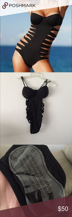 NWOT strappy monokini New with out tag. please ask any questions before purchasing. This item will only be traded for an autographed Authentic Chanel original, a Lamborghini, a penthouse in Paris, or the services of an Audi mechanic. All orders will be recorded before shipping. I do not model. Please see my reasonable offer chart before submitting an offer. Victoria's Secret Swim One Pieces