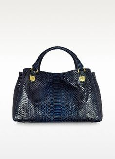 €1275.00 | Midnight Blue Phyton Leather Satchel Bag crafted from phython snakeskin in a striking blue hue has a roomy interior and an alluring texture perfect for your everyday essentials and elegant look. Featuring zip closure, double handles with detachable python leather shoulder strap, two external magnetic snap pockets, two internal zip pockets and two open pockets, external gold tone signature plate detail, signature lining and gold tone hardware. Made in italy.