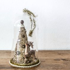 Reindeer and Tree Bell Jar x: Gorgeous vintage look hanging decoration with a deer and gold Christmas tree in a glass domed bell jar.