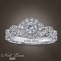 One of my favorites.  Smaller diamonds bring out the large one. Sparkle!