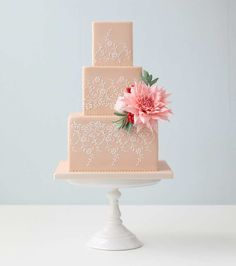 Embellished with an eye catching Dahlia made of sugar and a very subtle lace influence, this pink wedding cake would look beautiful at any wedding celebration