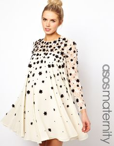 Maternity Swing Dress With Floral Applique...cute! I would wear this sans being pregnant