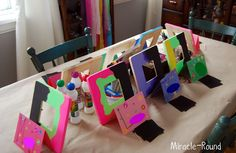 Fun painted frames...the black part is chalkboard paint