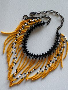 Native American style tribal fringed collar necklace in marigold, black and…