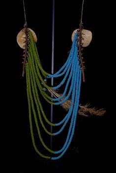a Crow loop necklace beaded in blue and green glass beads,brass beads, 2 circular horn plates, brass tacks, feathers with larger red and blue glass beads and 2 thick leather stripes. Native American Crafts, American Indian Art, Native American Indians, Native American Jewelry, Crow Indians, Cowboys And Indians, Indian Beadwork, War Bonnet, Indian Necklace