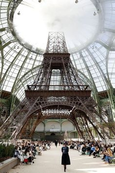 Chanel Couture fall 2017. Models walked underneath a giant Eiffel Tower replica that was created to overarch the runway. Photo, Getty Images