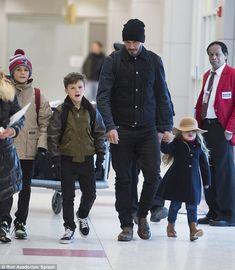 David Beckham - At JFK airport in NYC with children Romeo, 11, Cruz, 9 and Harper, 3.  (February 2015)