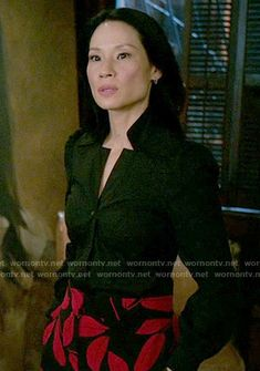 Joan's black and red leaf print trousers on Elementary.  Outfit Details: https://wornontv.net/57217/ #Elementary