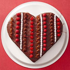 From the moist red velvet cake to the fudgy chocolate frosting, everything about this heart cake is decadent. Decorating it with raspberries, cherries, almonds, and pecans makes it more stunning; go ahead, treat yourself!