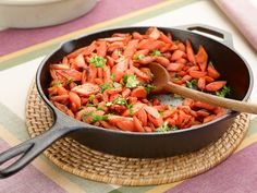 Get this all-star, easy-to-follow Cast-Iron Carrots with Curry recipe from Amy Thielen.