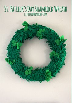 St. Patrick's Day Shamrock Wreath |  littleredwindow.com | Make this easy and adorable shamrock wreath covered in fluffy green grass and lucky shamrocks!