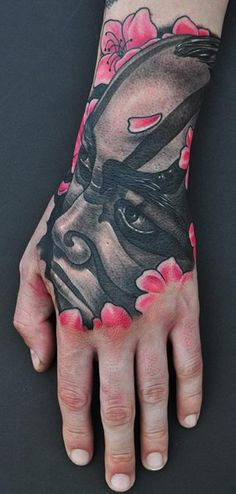Mike DeVries - email Kabuki Tattoo Placement: Hand Comments: Kabuki Tattoo. Part of a sleeve thats in progress.