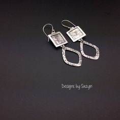 """These really special earrings are little works of art...and have been completely hand made by me.     These earrings have been meticulously created by me, by hand.  Each pair is one of a kind with hand drawn designs.      The silver is enhanced sterling silver, which is a blend of fine silver and sterling silver, making the silver content .960,  These earrings hang 2-3/4"""" from the top of my hand made Argentium  silver ear wires.  These are 3/4""""in diameter at the widest point. 