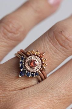 Sunset Ring Set by MinimalVS on Etsy. Orange and blue sapphires, gold, other stones.