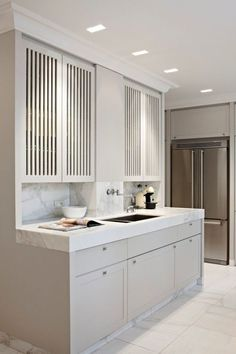 40 Ingenious Kitchen Cabinetry Ideas and Designs vertical louvered kitchen cabinets 40 Ingenious Kit Home Kitchens, Luxury Kitchens, Kitchen Design, Modern Kitchen, Kitchen Cabinet Doors, Kitchen Cabinet Styles, Kitchen Cabinetry, Kitchen Interior, Kitchen Style