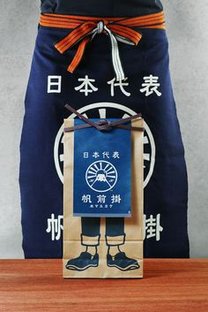In many Japanese stores like rice or miso shops, you could find that the people working traditionally wear a special type of apron, these are called Maekake. For their apron packaging, Anything, a …