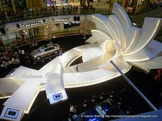 Fashion event stage and catwalk design; white dimensional ribbons