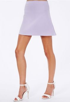 Join the #ALine craze this season in this simple yet eye grabbing #lilac #miniskirt. Perfect for adding a base to all your outfits. Simply add a #Missguided blouse, sandals and a side back.
