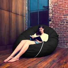 If I had this comfy pouf thing, I'd probably give up my bed. (That is a slight exaggeration. But it still looks freaking cool.)
