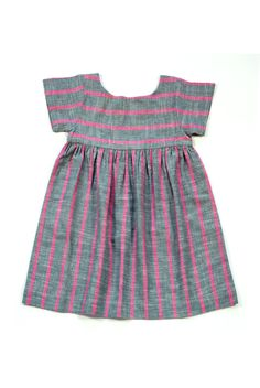 A very hardy piece that your child can grow into and wear for a few years as a dress or a tunic. The fabric is a beautiful handwoven cotton khadi. It is lined at chest and has a button closure at back