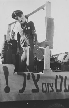 An effigy of Adolf Hitler hangs in the Landsberg DP camp during [what is probably a Purim celebration].