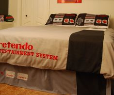 Power up your bedroom with the equally comfortable and geektastic retro Nintendo bed set. Inspired by the original 1980s Nintendo gaming machine, this geeky bedspread morphs your traditional bed into a giant old school multiplayer console.