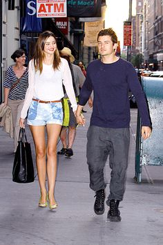 Dress up your fave denim shorts with a chic top and fun heels like Miranda Kerr. Totally adorable.