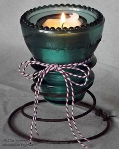 Quick and Easy Upcycle - Bed Spring and Insulator Votive - I used rusty bed springs from a friend's back yard and an aqua glass insulator from my garage to crea… Rusty Bed Springs, Box Springs, Bed Spring Crafts, Diy Bett, Glass Insulators, Insulator Lights, Electric Insulators, Glass Bottles, Old Beds