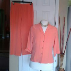 2piece 100%Silk Pant Suit Coral in color pant and blouse the pant has a fabric front with elastic and zipper back with clamp closure.  The blouse is button front with three quarter length sleeves. This suit is new with tags. Best color for any occasion. Maggy London Other